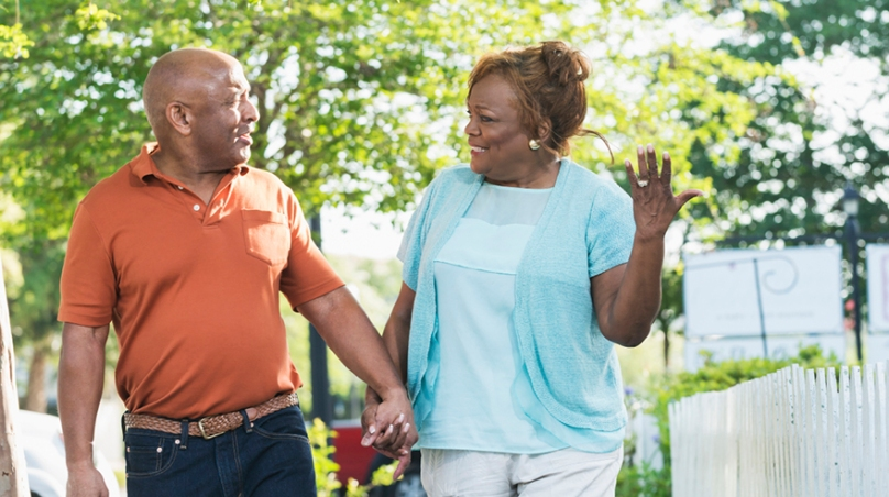 Senior black couple taking a walk holding hands